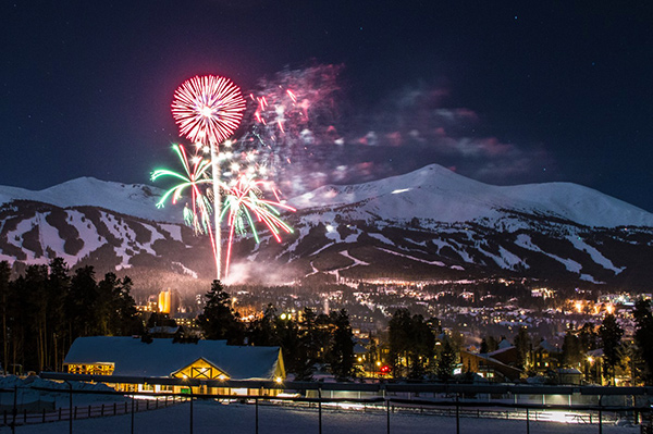 Fireworks above the Town of Breckenridge with the mountains and ski runs in the background