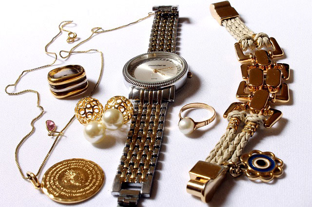 A picture showing a necklace, bracelet, watch, earrings, a ring and a pair of cufflinks.
