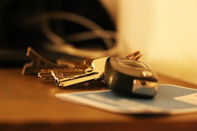 A pair of car keys on a table