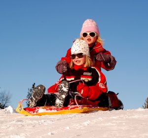 Two children on a sled.