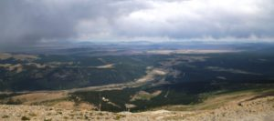 A vista on a cloudy day from the top of Hoosier Pass that shows the valley below.
