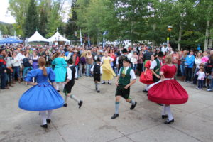 People in German costumes dancing for a crowd.