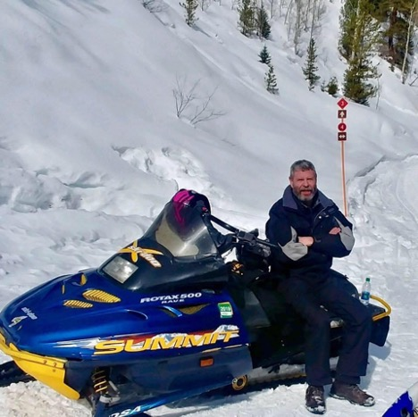 Todd on a snowmobile